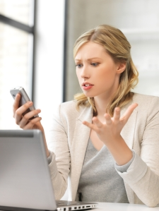 confused woman with cell phone