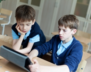 student and tablet in classroom