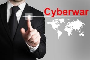 businessman in black suit pushing button cyberwar worldmap