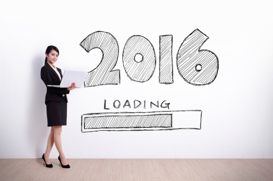 New Year is loading now - business woman using laptop computer with 2016 text and white wall background