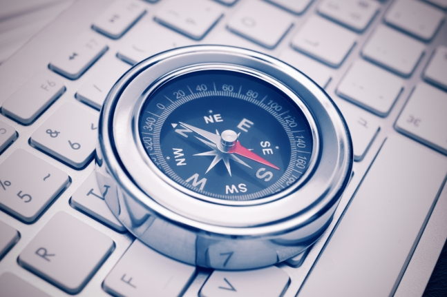 Compass on a keyboard. Internet search concept